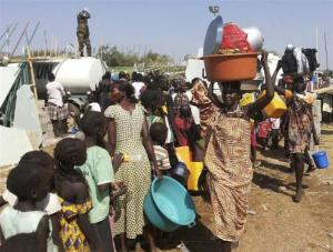 Civilians arrive to a shelter at the United Nations Mission in the Republic of South Sudan compound on the outskirts of capital Juba in South Sudan